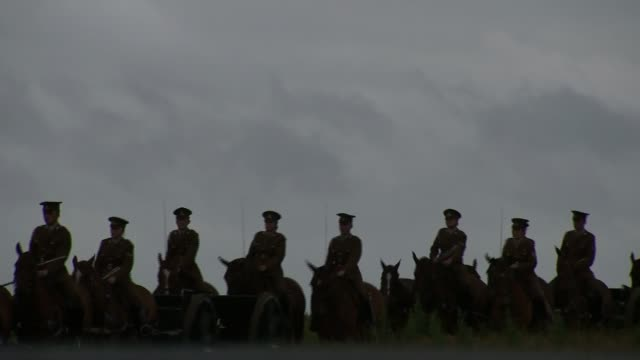 Battle of the Somme centenary Thiepval ceremony Men and women dressed in British World War One uniforms ride horses along near Somme battlefield site