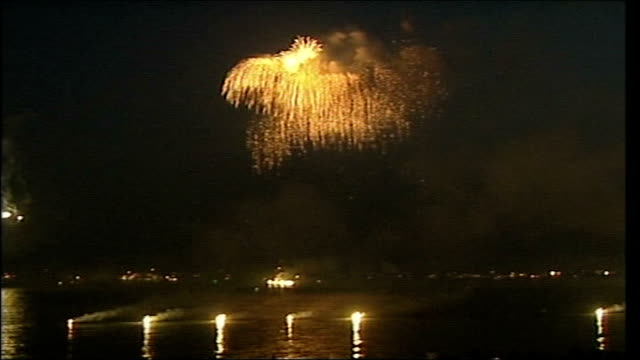 battle of trafalgar bicentenary celebrations: fly past and re-enactment; england: portsmouth: ext / night gvs fireworks above ships with spectators... - historical reenactment stock videos & royalty-free footage