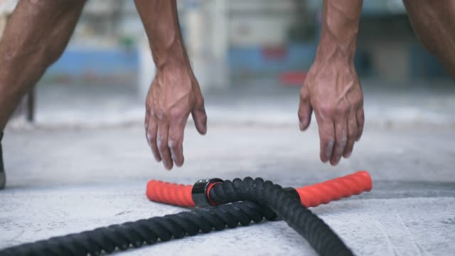 battle rope exercise in an abandoned warehouse - rope stock videos & royalty-free footage