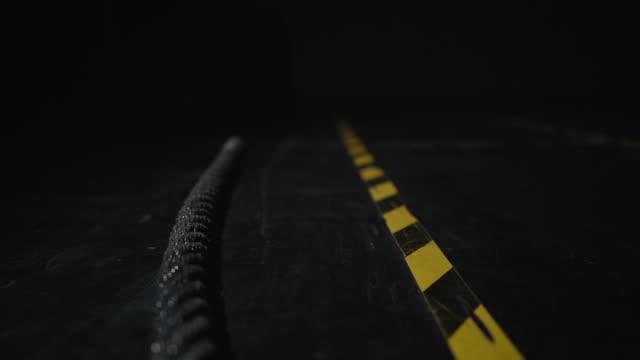 battle rep liggande på svarta golvet i gymmet - battle bildbanksvideor och videomaterial från bakom kulisserna