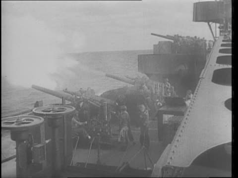 battle scenes from aircraft carrier / airplane takes off from carrier deck / montage of sailors readying for battle / montage of artilliary firing at... - 船の一部点の映像素材/bロール