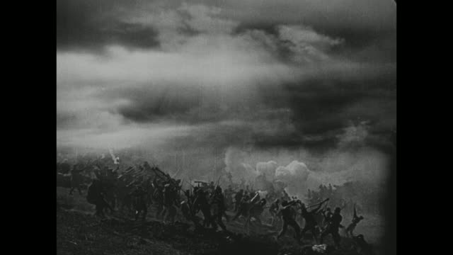 a battle takes place on a hillside as lightening strikes - anno 1916 video stock e b–roll