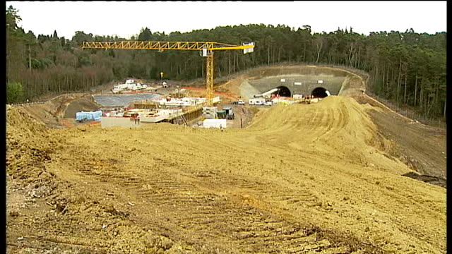 battle to save sir arthur conan doyle's former home; r26020910 hindhead: a3: devil's punch bowl: construction site tunnel for a3 under construction - arthur conan doyle stock videos & royalty-free footage