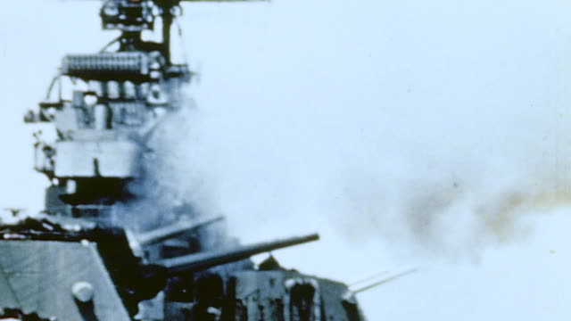 battleship bombarding the city with spotters wearing shouldermounted binoculars calling fire for naval gunners / naha okinawa japan - schlachtschiff stock-videos und b-roll-filmmaterial