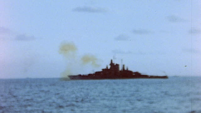 battleship bombarding the island / iwo jima, japan - iwo jima island stock videos & royalty-free footage