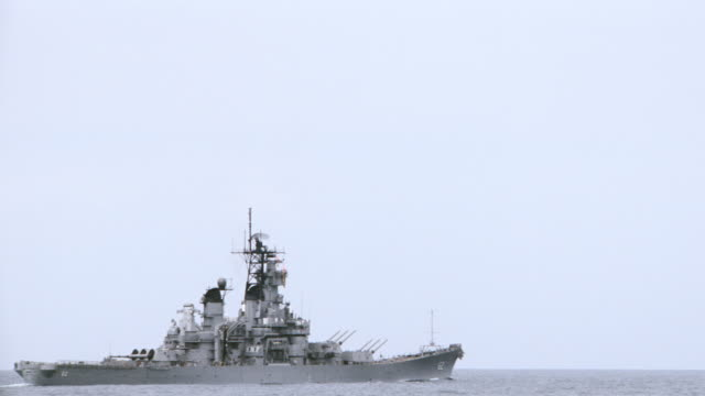 a battleship floats on the ocean. - us navy stock videos & royalty-free footage