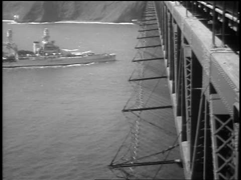 stockvideo's en b-roll-footage met b/w 1937 battleship going under golden gate bridge at grand opening / san francisco ca / newsreel - baai van san francisco