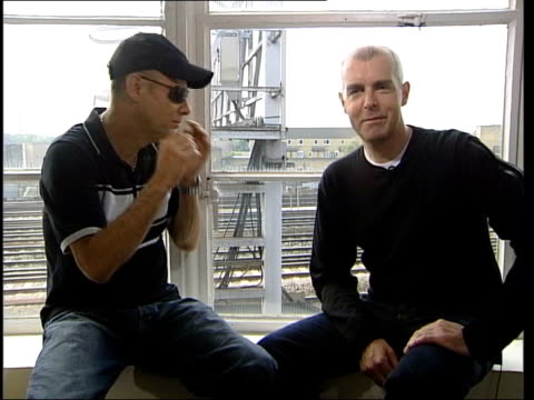 Battleship Potemkin score Pet Shop Boys interview ENGLAND London INT Chris Lowe and Neil Tennant seated before interview with reporter Nick Glass/...