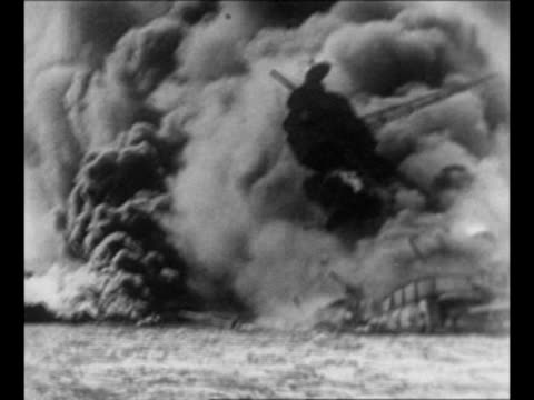battleship uss arizona engulfed in smoke and flame from direct hit by bomb during attack on pearl harbor / montage ships burn / from greatest... - 真珠湾攻撃点の映像素材/bロール