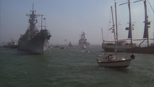 ms, battleship uss missouri and greenpeace sailboat surrounded by boats, san francisco harbor, california, usa - greenpeace stock videos & royalty-free footage