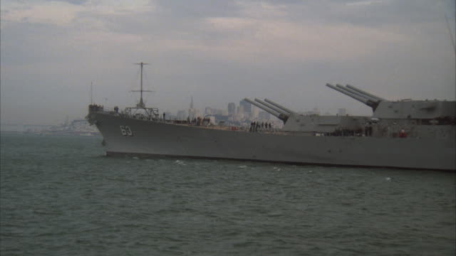 ms, pan, battleship uss missouri, city skyline in background, san francisco, california, usa - uss missouri stock videos and b-roll footage