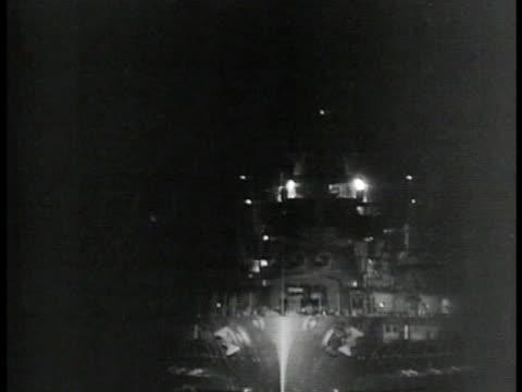battleship w/ forward lights flashing at night - 1935 stock-videos und b-roll-filmmaterial