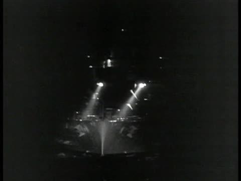 battleship w/ forward lights on at night - warship stock videos & royalty-free footage