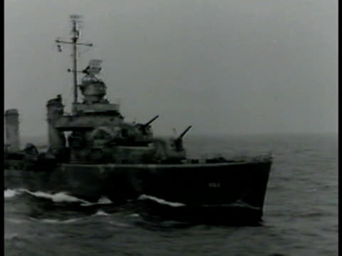 battleships at sea, camouflage painting. turrets on deck. single engine fighter airplanes w/ wings folded on carrier. sailor cleaning propellers.... - 1942 stock videos & royalty-free footage