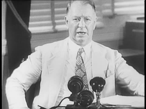 battleships move across the sea / navy secretary frank knox makes a long speech at a desk in favor of aggressive warfare against german u-boats. - 1941 stock-videos und b-roll-filmmaterial