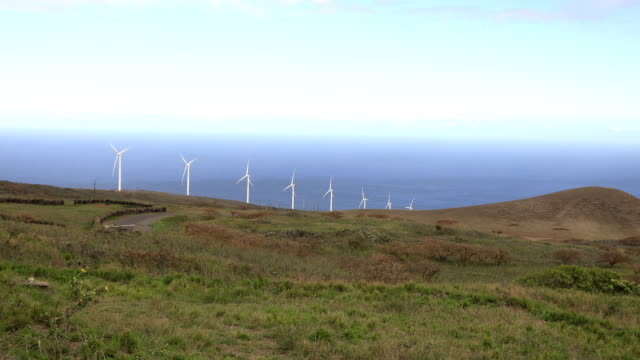battling global warming on maui island wind turbines - butte rocky outcrop stock videos & royalty-free footage