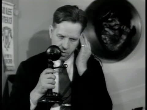 member 'baumeyer' dramatization int vs baumeyer answering telephone call in restaurant behind cash register ext ms baumeyer up stairs entering... - 1942 stock videos and b-roll footage
