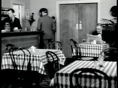 member 'baumeyer' dramatization ext ms baumeyer entering restaurant int ws walking to cash register ms checking register vs crowds entering back room... - 1942 stock videos and b-roll footage