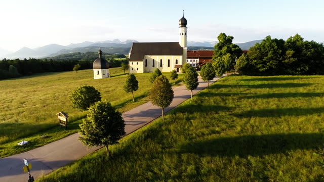 stockvideo's en b-roll-footage met bavaria landmarks - st.marinus and anian church - bavarian alps