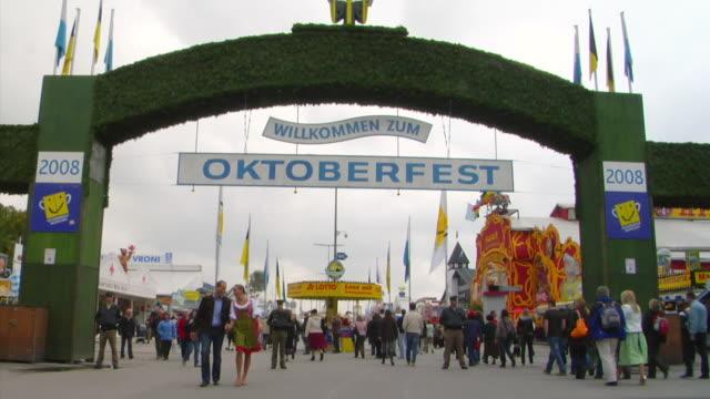 ws bavarian couple leaving oktoberfest, oktoberfest, munich, germany - oktoberfest stock videos & royalty-free footage