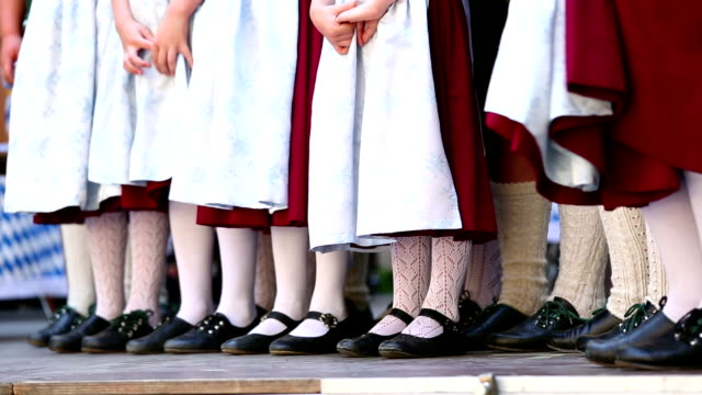 bavarian folk dance group with children is waiting - traditional dancing stock videos and b-roll footage