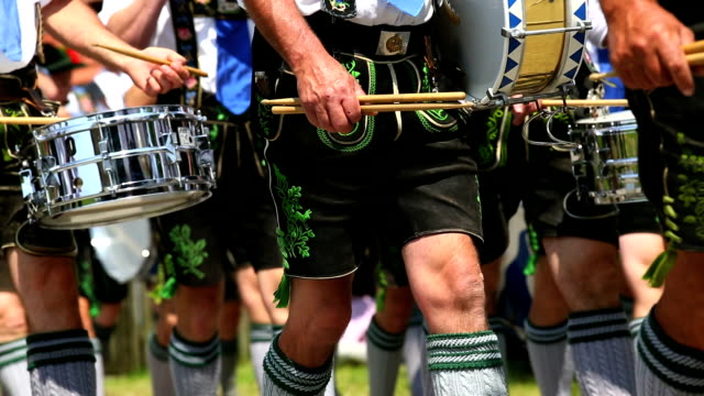 bavarian musicians playing in street parade ms - marching stock videos and b-roll footage