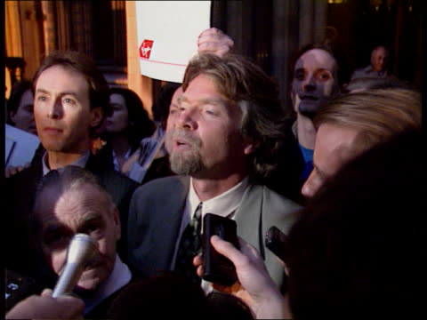 dirty tricks trial settled; at night branson out of court as surrounded by press cms intvw richard branson sof track around - victory for independent... - stunt stock videos & royalty-free footage