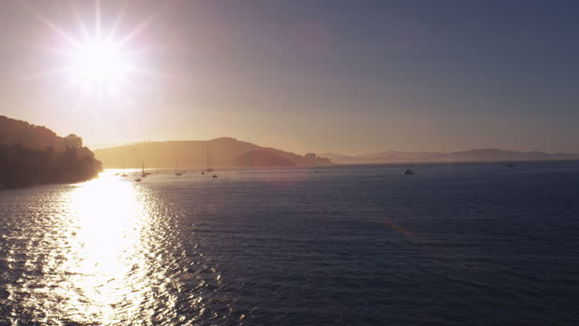 bay area in the sunset with boats sailing near shore - san francisco bay stock videos & royalty-free footage