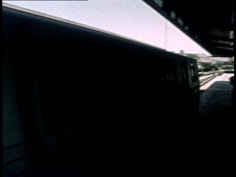 vídeos y material grabado en eventos de stock de 1975 bay area rapid transit cars traveling down tracks and passengers riding inside bart cars / san francisco, california, united states - bart