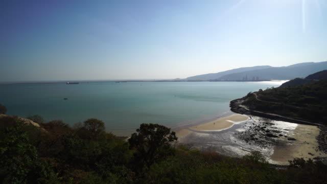 bay beach and island, seen from hill top - 見渡す点の映像素材/bロール