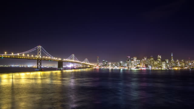 bay bridge nighttime lights - time lapse - san francisco oakland bay bridge stock videos and b-roll footage