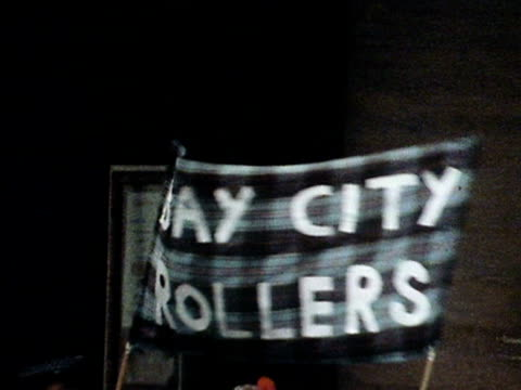 bay city rollers fans queue up outside a concert hall 1975 - concert hall stock videos & royalty-free footage