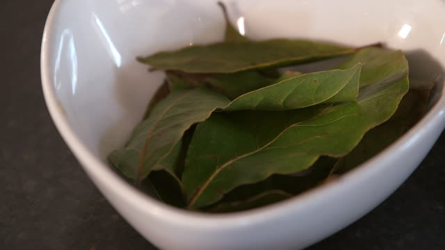 bay leaves in a bowl - alloro video stock e b–roll