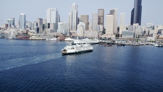 bay moving towards city of seattle aerial - ferry stock videos & royalty-free footage