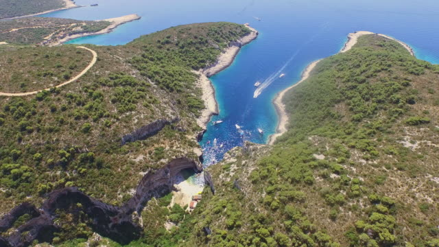 aerial bay stiniva cove on vis island - bay of water stock videos & royalty-free footage