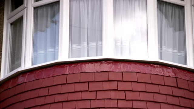 bay windows of a 1930s house in rayners lane district of london. available in hd. - erkerfenster stock-videos und b-roll-filmmaterial