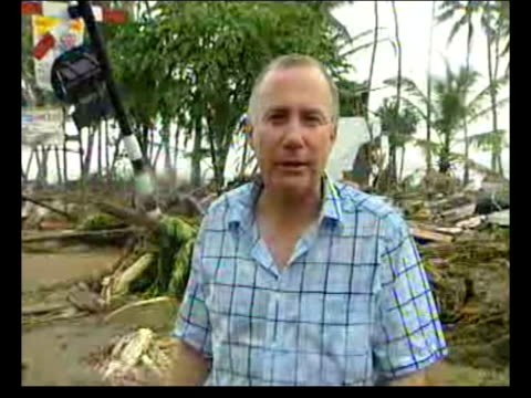 bayagala ext poor quality pix pixillated pictures of devastation caused by tsunami track cs rain dripping off corrugated iron roof ms man under... - 2004 stock-videos und b-roll-filmmaterial