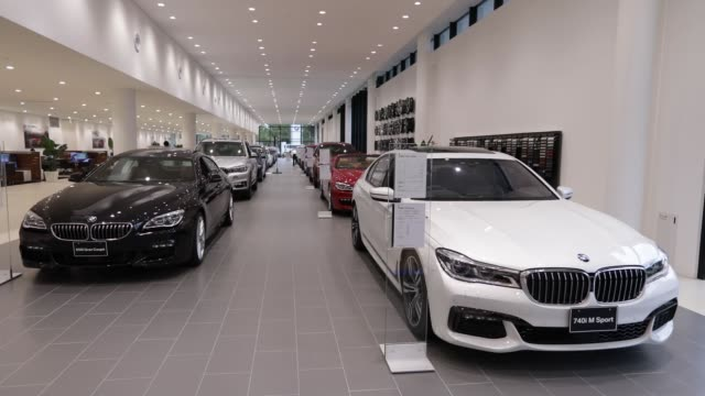 bayerische motoren werke ag automobiles including a 740i m sport sedan right and 650i gran coupe m sport sedan left stand on display at the bmw group... - limousine familienfahrzeug stock-videos und b-roll-filmmaterial