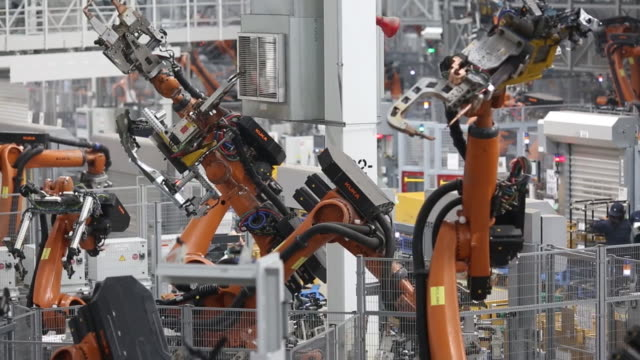 a bayerische motoren werke ag sports utility vehicle body frame progresses down an assembly line at the bmw manufacturing co assembly plant in greer... - car plant stock videos and b-roll footage