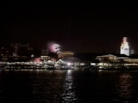 stockvideo's en b-roll-footage met miami florida night xws bayside marketplace w/ fireworks exploding in sky bg - biscayne bay