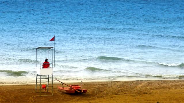 baywatch controls the sea on beach