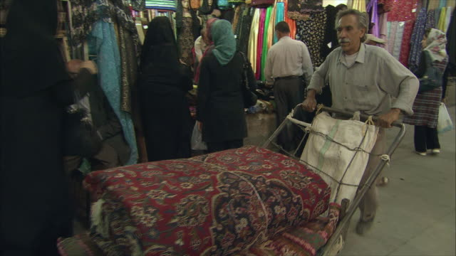 MS PAN Bazaar scene with senior man pushing cart, Shiraz, Iran
