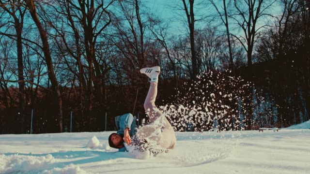 slo mo b-boy doing acrobatic moves in the snow - stunt stock videos & royalty-free footage