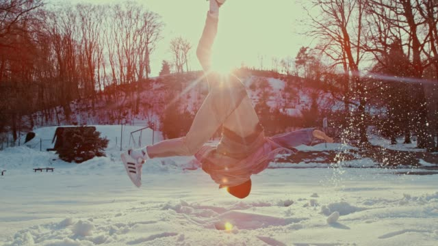 slo mo b-boy performing a somersault in the snow - acrobatic activity stock videos and b-roll footage
