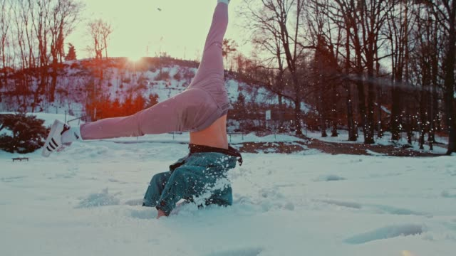 slo mo b-boy spinning on his head in the snow - stunt stock videos & royalty-free footage