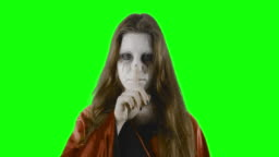 Be warned! - teenage girl, disguised for Halloween or a costume party, against a green screen