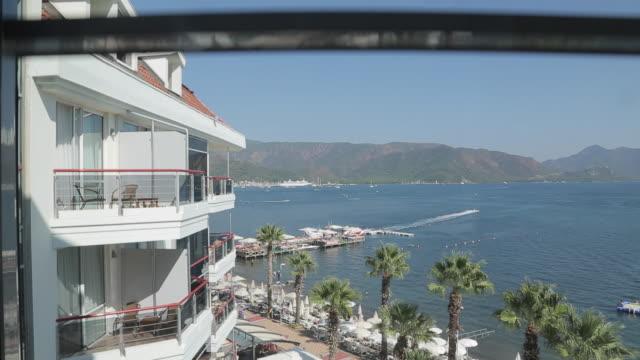 beach & aegean sea from hotel lift, marmaris, anatolia, turkey - fahrstuhlperspektive stock-videos und b-roll-filmmaterial