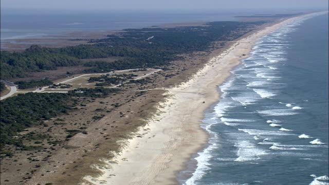 beach along ocracoke island  - aerial view - north carolina,  hyde county,  united states - carolina beach stock videos & royalty-free footage