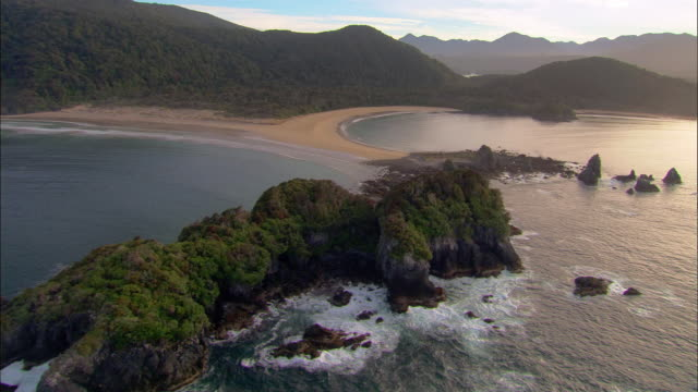 low aerial, beach and solander islands, new zealand - new zealand stock videos & royalty-free footage
