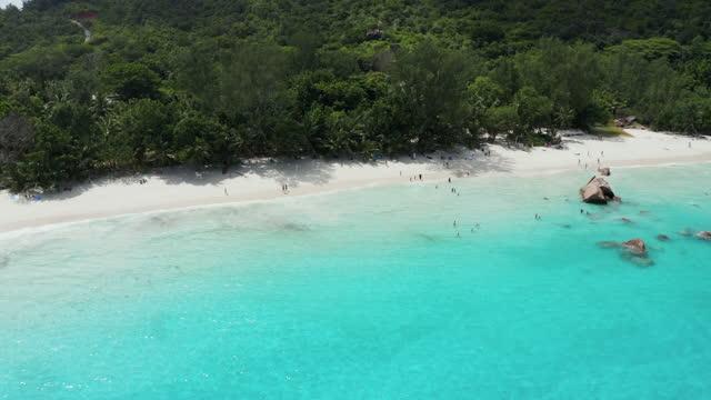 beach anse lazio, praslin island, seychelles (authorized flight) - island stock videos & royalty-free footage